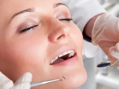 Woman's relaxed face while enjoying gentle dentistry