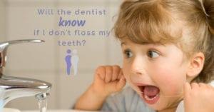 Little girl flossing her teeth at sink