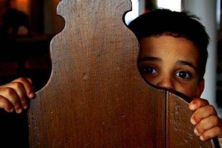 Person Hiding behind a chair in fear